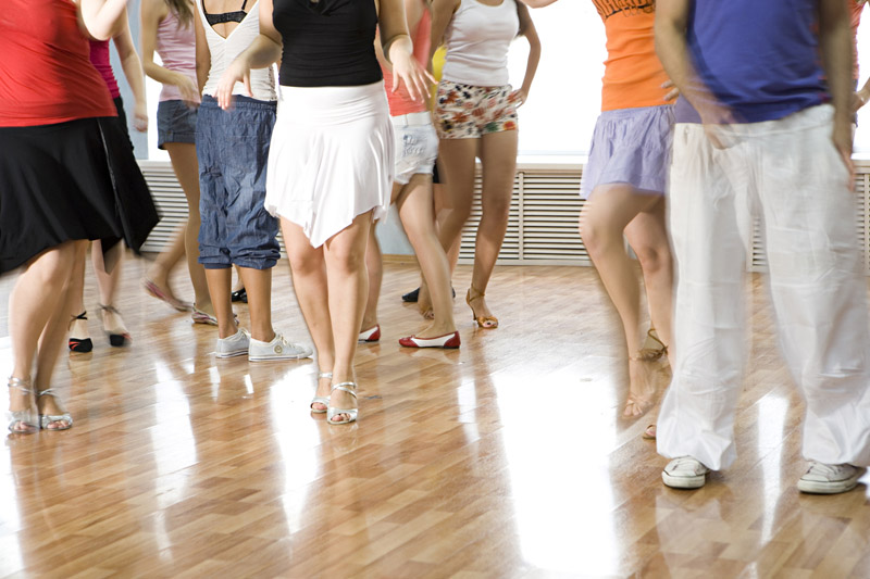 Man's and Female Feet in Training Dance Position with the effect of movement. In a Dance Class.